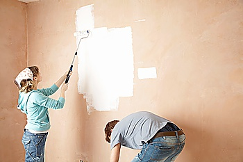Couple Painting Room Together