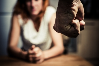 Young woman being the victim of domestic abuse