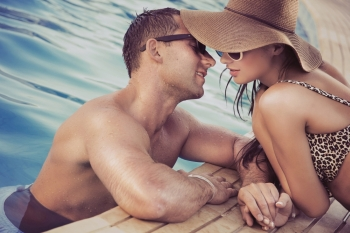 Adorable couple at the swimming pool