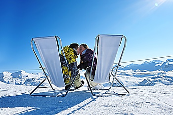 Couple at mountains in winter, Val-d´Isere, Alps, France